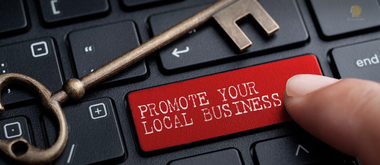 Index finger, press enter, black keyboard, bronze key, promote your local business