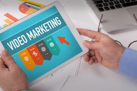 video marketing, man holding tablet,